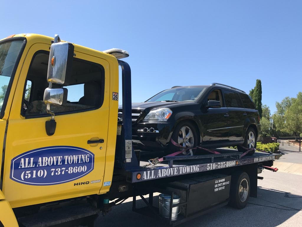 Image of Towing Truck with a yellow car1,All Above Towing LLC ,Tow truck Company