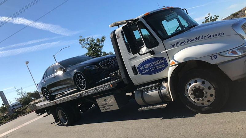 Image of Towing truck with a black car6,ALL Above Towing LLC ,Tow Truck Company