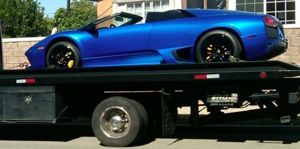 Image of Luxury Towing with a Blue car,ALL Above Towing LLC,Tow Truck Company